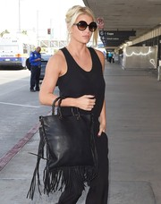 Jessica Simpson hid her eyes behind a chic pair of oversized round sunnies as she made her way to LAX.