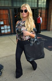 Jessica Simpson was trendy and sexy in a sheer floral cold-shoulder blouse by Preen while out in New York City.