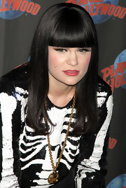 Jessie J styled her jet black mane in a straight cut with blunt cut bangs at Planet Hollywood in New York.