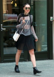 Jessie J was spotted out in New York City looking preppy in a pleated black mini skirt.