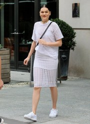 Jessie J was in the mood for all white, teaming her shirt and skirt combo with a pair of canvas sneakers.