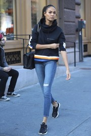 Joan Smalls teamed her top with ripped skinny jeans.