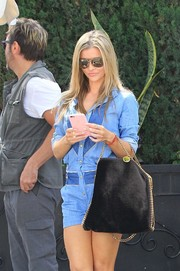 Joanna Krupa was spotted out carrying a black Stella McCartney Falabella bag.