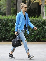 Gigi Hadid was biker-chic in a bright blue leather jacket by Elizabeth and James while out and about in West Hollywood.