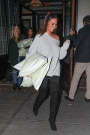 Chrissy Teigen looked comfy and chic in her grey sweater while out in NYC.