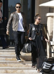 Chrissy Teigen teamed a sheer black maxi skirt with a leather jacket for a day of shopping.