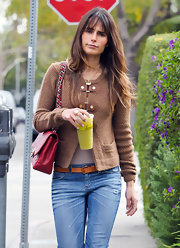 Jordana Brewster kept things simple in a tan cardigan with leather buckles.