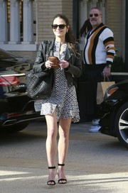 Jordana Brewster paraded her shapely legs in a printed mini dress while shopping at Barneys.