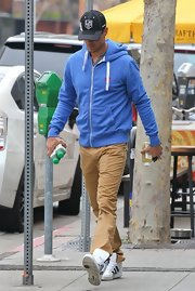 Josh Duhamel chose a blue zip-up hoodie for his casual on-the-go look.