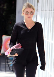Julianne Hough was spotted working out holding a black leather quilted clutch.