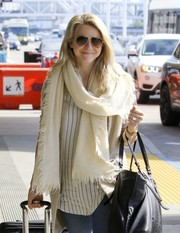 Julianne Hough accessorized with an oversized white scarf for a flight out of LAX.