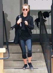 Julianne Hough stepped out of the gym wearing a black shawl-collar cardigan and two-tone leggings.