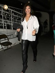Julie Chen paired a loose white blouse with leather skinny pants for a dressy but casual look.