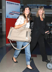 Julie Gonzalo opted for comfy ballet flats when she departed on a flight from LAX.