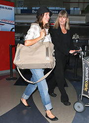 Julie Gonzalo was spotted at LAX carrying a huge beige duffel bag.