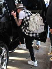 Justin Bieber arrived on a flight at LAX carrying a white MCM backpack.