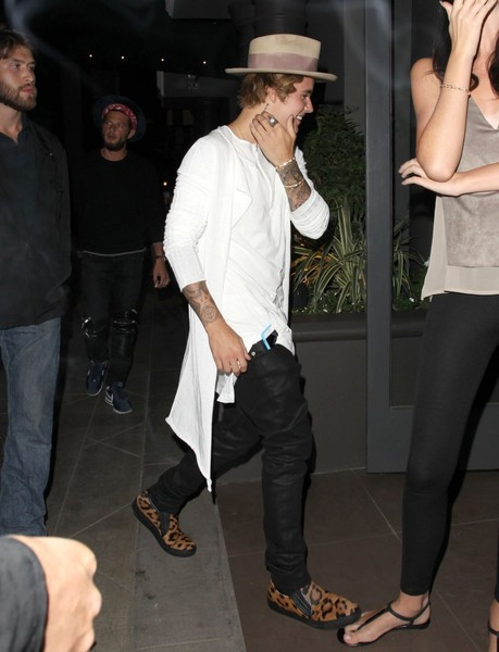 For his shoes, Justin Bieber chose a pair of animal-print slip-ons. Oops, he stepped on that girl's foot!