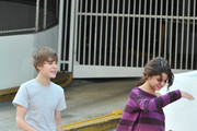 Justin Bieber and rumored girlfriend Selena Gomez tried to go out for a romantic stroll in Miami today before his concert, but were met by a swarm of paparazzi. Justin and Selena have been denying their romance since they were seen having breakfast together last week.