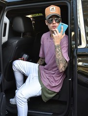 Justin Bieber sported a tan New Era x XLARGE trucker hat while out in Miami.