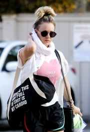 Kaley Cuoco left yoga class carrying a slogan duffle bag by 2Nostalgik.