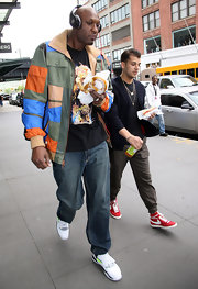Lamar Odom added a bright pop of color to his outfit with this zip-up jacket while out on a stroll in New York.