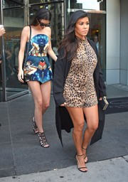 Kourtney Kardashian completed her head-turning look with a pair of black ankle-strap sandals.