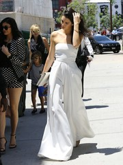 Kendall Jenner stunned on the streets of Hollywood in this strapless white Solace London jumpsuit.