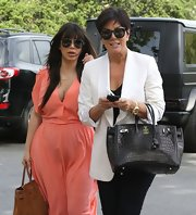 Kris Jenner dressed up her look with a sleek white blazer.