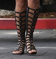 Kourtney Kardashian chose a pair of knee-high gladiators for her chic daytime look.