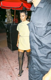 Kourtney Kardashian went for an ultra-sexy finish with a pair of black fishnet over-the-knee boots by Tom Ford.