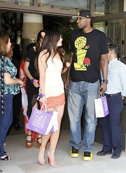 Lamar Odom kept it casual with ripped jeans, a t-shirt, and sneakers during a party with the Kardashian family.