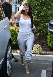 Kim Kardashian teamed her top with a pair of pale-gray sweatpants by Champion.