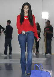 Kim Kardashian flaunted her curves in these blue flared jeans while out checking out retail spaces in Hollywood.