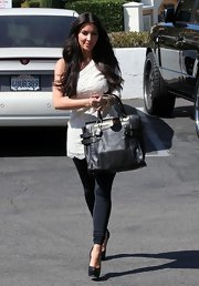 "Kim carries the ""Shelby Shopper"" bag while out on a spree."