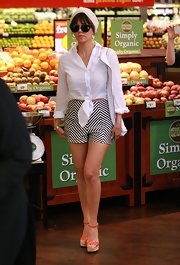 Kourtney looked retro chic with this white tied button down and a pair of striped shorts.