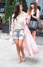 Kourtney Kardashian teamed her shorts and coat with a white Joe's button-down featuring a subtle animal print.