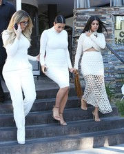 Kourtney Kardashian finished off her eye-catching outfit with a white mesh maxi skirt.