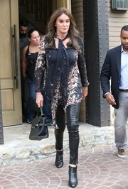 Caitlyn Jenner kept it ladylike up top in a printed tie-neck blouse during her birthday celebration.