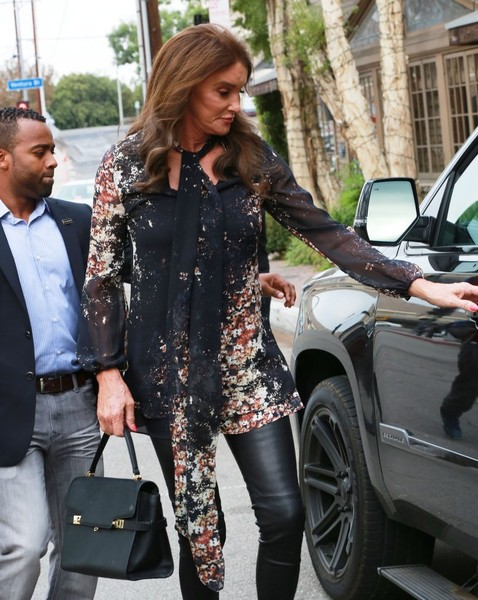 Caitlyn Jenner carried a Henri Bendel Uptown bag, in black, while attending her birthday celebration.