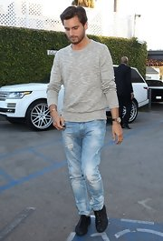 Scott Disick's distressed denim added a casual touch to his daytime look while out dining with this family.