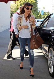 Kourtney Kardashian chose a pair of distressed denim for her casual and comfy daytime look.
