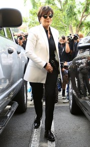Kris Jenner completed her outfit with black patent oxfords.