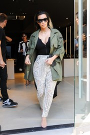 Kim Kardashian contrasted her glamorous pants with a tough-looking military jacket.