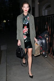 Karlie Kloss looked adorable in a floral cheongsam while attending a birthday party in New York City.