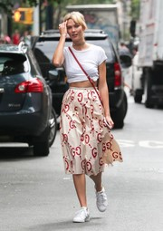 Karlie Kloss channeled the '50s with this Gucci flared skirt teamed with a tie-waist tee while out in Soho.