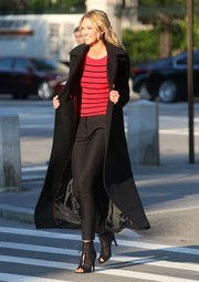 Karlie Kloss did a photo shoot in New York City wearing black cigarette pants and a striped sweater.