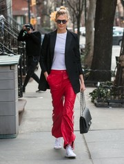 Karlie Kloss chose a pair of Adidas Originals Matchcourt High Rx sneakers to finish off her outfit.