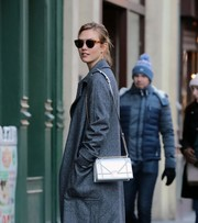 Karlie Kloss accessorized with a pair of modern round sunnies while out on a stroll.