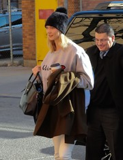 Karlie Kloss kept it nice and toasty in a black fur beanie while out in New York City.