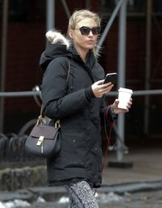 Karlie Kloss stepped out in style carrying a black chain-strap bag by Chloe.